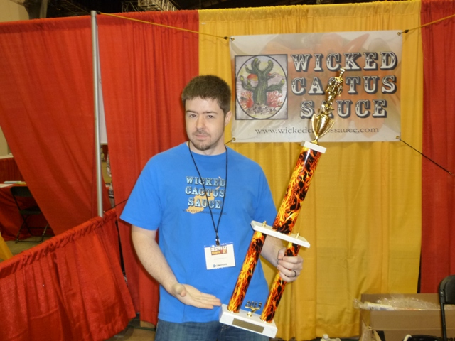 Mike from Wicked Cactus holds his Feast Your Eyes on This trophy